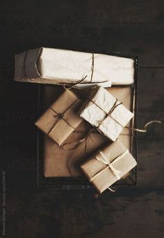 packages wrapped in kraft paper and golden twine