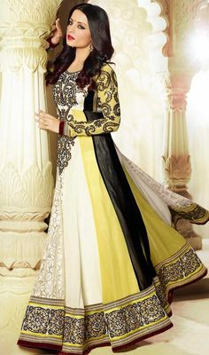 Reflect timeless elegance like Bollywood diva Celina Jaitley dressed in this black, off white and yellow georgette floor length Anarkali suit. The beautiful lace, resham and stones work throughout attire is awe-inspiring. #BollywoodAnarkaliCollection
