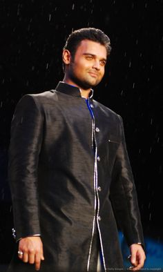Indian Bollywood actor Mahaakshay Chakraborty displays a creation by designer Shaina NC