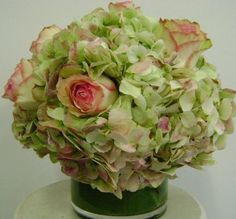 This is a floral arrangement that features antique hydrangea and roses.  See our entire selection at www.starflor.com.  To purchase any of our floral selections, as gifts or décor, please call us at 800.520.8999 or visit our e-commerce portal at www.Starbrightnyc.com. This composition of flowers is generally available for same day delivery in New York City (NYC).  LV007