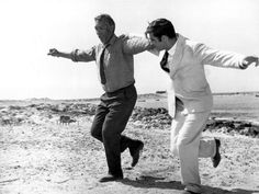Anthony Quinn and Alan Bates on the set of 'Zorba The Greek' (1964)