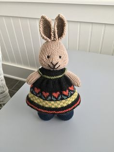 This dress was inspired by American Folk Art colors and designs. The Knit Picks Palette yarn has great definition for the design. I did need to add a few rows for length since the yarn seemed a sma. Crochet Rabbit, Knit Or Crochet, Cute Crochet, Crochet Toys, Knitted Bunnies, Knitted Animals, Knitted Dolls, Knitting Charts, Knitting Patterns