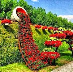 Pic: Garden art: Cascading flowers in pot growing over hedge. From the vertical garden board Topiary Garden, Garden Art, Garden Design, Diy Garden, Amazing Gardens, Beautiful Gardens, Beautiful Landscapes, Garden Projects, Pallet Projects