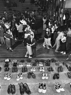 """Shoeless teenage couples dancing in HS gym next to bleacher where rows of their shoes have been checked to avoid marring the facility& hardwood floors during a Sock Hop, the latest craze to sweep the nation& youth."" Oklahoma, 1946 by Alfred Eisenstaedt Lindy Hop, Rockabilly, Retro 50, Life In The 1950s, Teenage Couples, The Last Summer, Yoga Pilates, Photo Vintage, Vintage Style"
