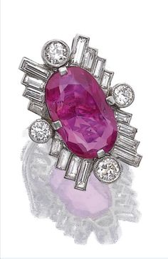 Ruby and diamond ring, late 1930s. The oval ruby claw-set within a surround of baguette and circular-cut diamonds,