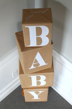 baby blocks made out of diapers wrapped in brown paper // ideas for a Gender Neutral Baby Shower