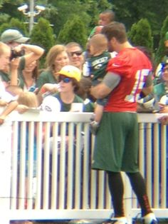 Tim Tebow and fans (June 13, 2012) Love the mismatched outfit. looks like a color combo i would do.