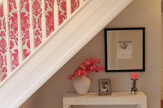 I like the idea of the wall paper being a feature on the stairs with a small amount of detail under the stairs.