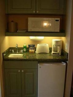 kitchenette - for me it would need a bit larger sink, but it uses the space well.