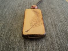 Bamboo Tile Wood Pendant, Woodburned Single Feather on Etsy, $15.00