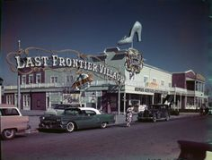 """Front entrance to the Last Frontier Village in Las Vegas, circa 1950s. The Silver Slipper Gambling Hall is seen in the foreground. Part of the UNLV Libraries """"Dreaming the Skyline: Resort Architecture and the New Urban Space"""" digital collection."""