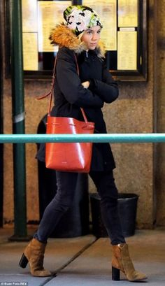 Sienna Miller wearing Woolrich Arctic Parka in Black