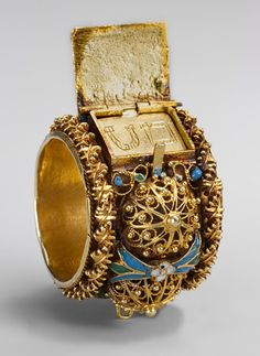 "Jewish betrothal ring, ca. 17th–19th century Venice or Eastern Europe Inscribed: MEM and TAV, the Hebrew initials for Mazel TovIt. he groom would place it on the bride's finger, but after the ceremony the ring would have been kept as a prized memento by either the family or the temple community. The gable roof—perhaps symbolizing the Temple of Jerusalem—opens to reveal the words ""Good Luck."""