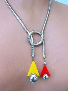 Modernist Necklace by BENGEL.   Red and yellow galalith and chrome knotted snake chain necklace by the Jakob Bengel company. It measures 17 inches (43cm) from clasp to clasp and the central knotted section measures a further 3.5 inches high (9cm).