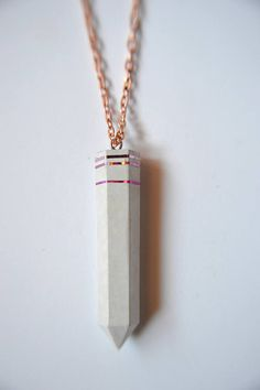 This is a modern and youthful necklace made of a special jewelry concrete which has a shiny and very smooth surface.  It is decorated with 3 shiny pink stripes and has a 70 cm long chain.  Total weight: 5-6 gramm  Unique requests are welcome, so do not hesitate to contact me to create your own concrete jewelry