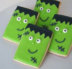 I originally wanted to make scary Frankenstein cookies. A little something different in the world of cute cookies, but when it came time to pipe on Frankenstein's face, I just couldn't … Halloween Snacks, Cookie Halloween, Halloween Biscuits, Halloween Cookies Decorated, Halloween Sugar Cookies, Halloween Goodies, Decorated Cookies, Halloween Halloween, Ghost Cookies