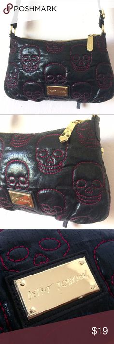 Betsey Johnson Crossbody Bag w Embroidered Skulls This bag is so fresh! I wouldn't even think of parting with it but I don't have much gold in my wardrobe.  Brand new, never been used. Awesome black bag with red Embroidered skulls. A small, almost unnoticeable scratch on the name plate. Really rad graphic printed lining. This bag is dope! Betsey Johnson Bags Crossbody Bags