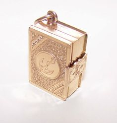 This 14k gold lords prayer book jewelry charm is an exquisite rare antique victorian 14k gold book locket charmpendant 6 places for photos aloadofball Gallery