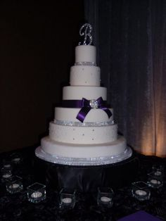 Oh my goodness, I love this cake!  Love the bling!  Would like a little more purple on it, though.