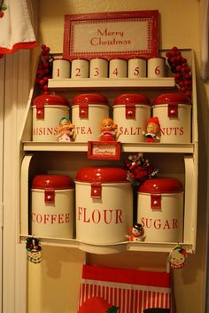 A stunning set of vintage red and white tin kitchen canisters. They look like the vintage TALA bakeware. It still is incredible set of vintage kitchen canisters!