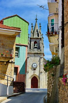 Corcubión, Galicia - Spain... love the church bell & flower balconies