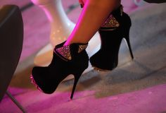 Black heel boots with glitter.