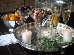I love to use martini glasses for serving olives and nuts, it's a great use for the glasses if no one is drinking martini's!