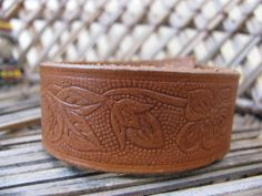 Beautifully carved up-cycled leather bracelet.