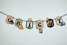 Banner made using the Cricut, and the create a critter cartridge, Elegant Edges and Carousel (lite). Super cute to do for a kids room in their name!