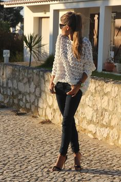 Dark blue jeans with white sheer top.  Love the chevron top...not the shoes so much. Cowboy boots?
