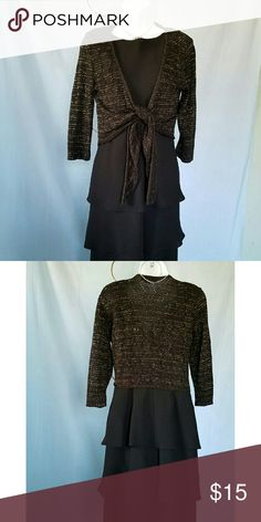 """KIKIT BLACK SPARKLY METALLIC GOLD SHRUG M KIKIT BLACK METALLIC GOLD SHRUG  This gorgeous shrug will look great over many of your sleeveless dresses this winter. The metallic gold makes it look very festive and has a look of eyelet. It has a tie front and 3/4 sleeves. Armpit to armpit is 17.5"""" and shoulder to hem length is 18"""". It is 95% acrylic and 5% metallic. Kikit Jackets & Coats Capes"""