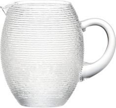 Rippled organic texture lends a frosty look to fruit punches, margaritas, or iced water.  Clear welcoming handle invites a cool pour from generously sized rounded pitcher with a pert little spout, handcrafted by master Italian glassmakers. Handmade glassNot for use with hot liquidsHand washMade in Italy.