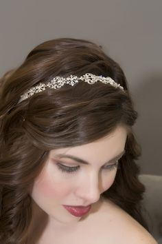 The Cadence Bridal Bandeau is the perfect addition to any bridal style. Completely hand crafted on soft silk ribbon and create with an antique sterling silver patina and set with sparkling Swarovski crystals; the finished edges create an added aura of elegance. $299.00 #weddingaccessories #wedding hairstyles #bridalaccessories #bridalhairstyles