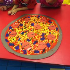 My kids loved making a Class Pizza. Each child has a pepperoni with their name and we uses various craft materials for toppings.