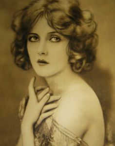 Mary Nolan - in this picture I also see Drew Barrymore.  There are only about 6 or 8 faces, really.