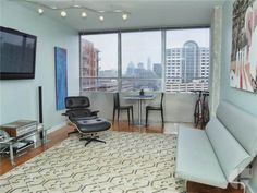 Brilliant affordable modern condo in classic downtown international style building.   Price: $139,000  Details: 602 sq/ft 1 Bed, 1 Bath