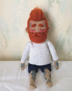 A personal favourite from my Etsy shop https://www.etsy.com/listing/469647994/cloth-doll-baby-beardy-with-tattoos