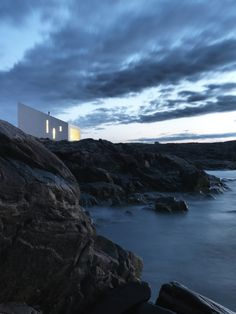 The Squish Studio, like most of its other counterparts, is equipped with a compost toilet, a small kitchenette and wood-burning stove. Power is supplied by stand- alone solar panels, mounted on an adjacent hilltop.   At night, the studio, illuminated by the soft glow of its solar-powered lighting, appears as a lantern or a lighthouse placed strategically on a rocky cliff to over- look the North Atlantic.