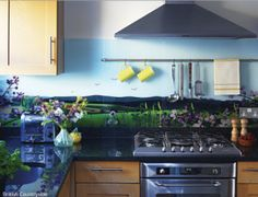 Wow these glass splashbacks are fantastic! I'd love one behind my hob (which is recessed into the chimney breast). Perhaps a tropical beach or coastal British scene?