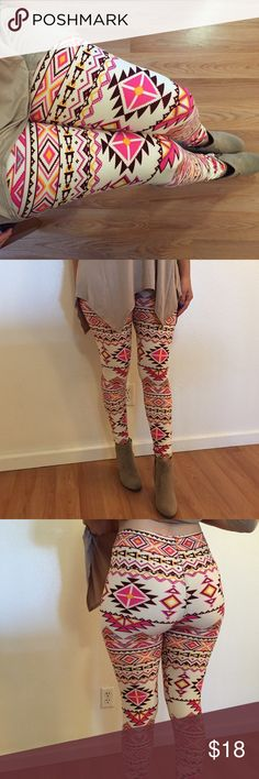 Pink Aztec Ankle Leggings Aztec Print Brushed Ankle Leggings Get cozy with this cute and super soft brushed legging, featured in a pink Aztec tribal print. With its smooth, comfortable fit. Wear these with a dressy top and a sexy pair of heels for a classy going out look, or an oversized off-the-shoulder top for a casual day ensemble. Paneled elastic waistband Approx. 27 in. inseam 92% polyester, 8% spandex. Machine wash. No trades. One size. Would best fit a small-medium. Pants Leggings