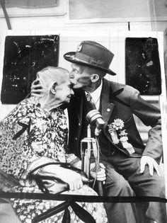 This photo, from the collection of the Union Veterans of the Civil War, shows Alice Carey Risley, 89, the last surviving Civil War battlefield nurse, receiving a kiss from a veteran. 1936