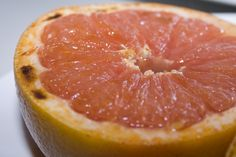 5 Minute Candy (Broiled Grapefruit)  Instead of the Brown Sugar, I'll try coconut palm sugar.