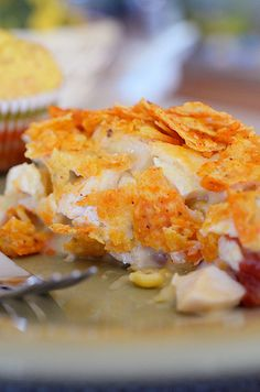 King Ranch Chicken- Family favorite!   4 skinless, boneless chicken breasts, cooked and shredded or cubed  1 can cream of mushroom  1 can cream of chicken  1 can (10 oz) Rotel (diced tomatoes with green chiles)  1 can (15.25 oz) whole kernel corn, well drained  1 cup crushed Doritos, cheese flavor preferred  2 cups shredded Mexican blend cheese (just Monterrey Jack or Cheddar works, too)