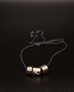 [Shibuichi necklace] 3 tubes on a chain... just hanging out.  . . . . . . . . . . .  #michellekraemerjewellery #easytowearhardtoignore   #allblackeverything #blackismyhappycolour #allblackerrthing #blackjewellery #blacksilver #advancedstyle #40plusstyle #styleoverfashion #uniquejwellery #unikatschmuck #schmuck #oneofakind  #shibuichi #japenesealloys #silver #oxidisedsilver #golden Advanced Style, All Black Everything, Hanging Out, Black Silver, Arrow Necklace, Tube, Cufflinks, Chain, Accessories