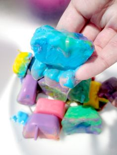 """Made with cornflour, water & colour, 'Freezy Goo' is icy cold & acts as both a liquid & a solid interchangeably. It starts out as ice & slowly transforms to GOO! ("""",)"""