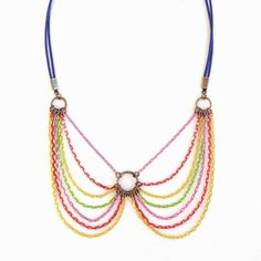 Spring into fashion with electrifying hues of the season. Fun won't be far behind wearing this cool collar necklace!