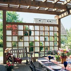 Glass-Block Trellis        Add privacy to a patio with a trellis punctuated by glass blocks. The light pattern that shines through the glass blocks, which came from an old dairy, changes with the movement of the sun. The homeowners chose heavy wood posts for the pergola to complement a large house and yard.