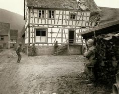 Seventh Army men looking for snipers in the Bobenthal, Germany General Charles Day Palmers Recently Discovered Pictures Show The Horrors Of The Nazi Retreat