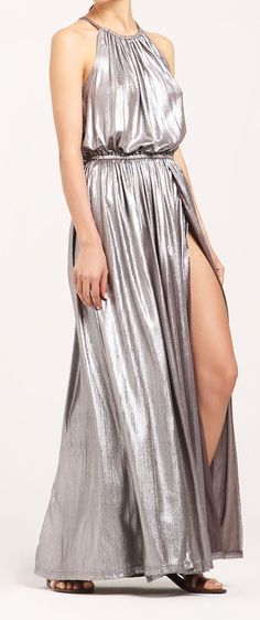 Channel Studio 54 in this 70s-inspired halterneck maxi dress. Crafted in a metallic brown jersey fabric, this dress is designed with an elasticated waist. http://www.paisie.com/collections/dresses/products/silver-halterneck-draped-jersey-maxi-dress