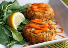 Baked Lump Crab Cakes with Red Pepper Chipotle Lime Sauce.  The baked crab cakes are out of this world! You'll think they came from a high end restaurant.  Serve these as an appetizer or enjoy as a meal with a salad.  I highly recommend using fresh crab meat rather than canned for best results. Do not skip refrigerating the patties before baking, this really helps them stay together.